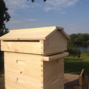 Beecentric Hive with insulated Warre hive style quilt box and vented roof.